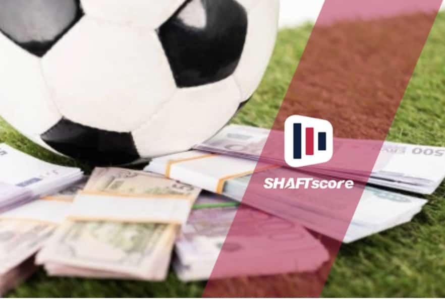 Imagem ilustrativa de uma bola de futebol e dinheiro. Apostador.