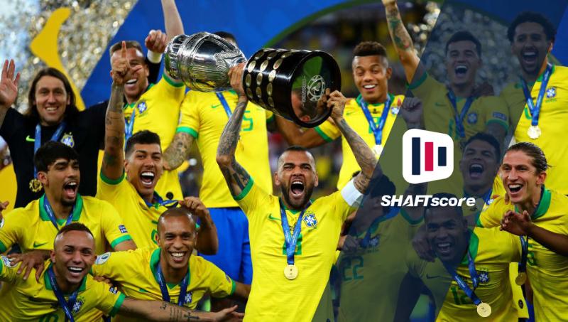 Time da Seleção brasileira comemorando titulo com a taça na mão