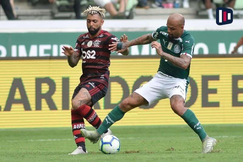 Gabibol e Felipe Melo disputando a bola em Flamengo x Palmeiras